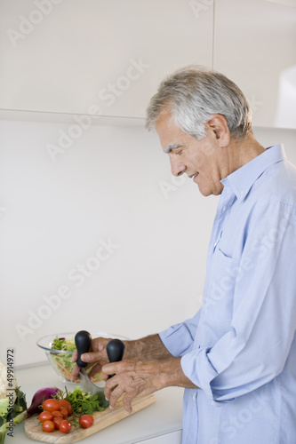 Mature man preparing food