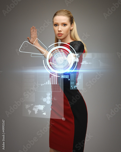 woman working with virtual touchscreens