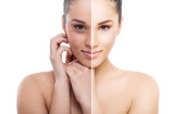 A split photo of a woman before and after retouch poster