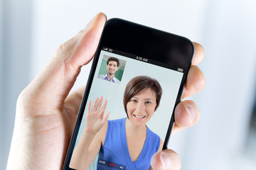 Couple enjoying a video call from a smartphone