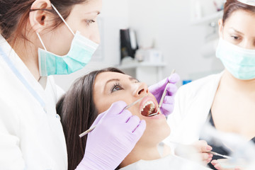 Woman having checkup at dental surgery