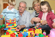 Grandparents and grandchildren playing together