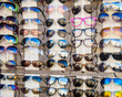 Many sunglasses on display in shop