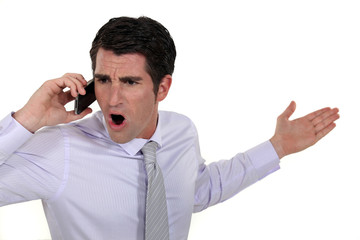 angry businessman talking on his cell