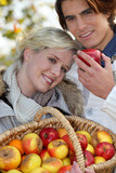 Couple with basket of apples
