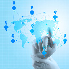 Medical Docto rhand  pointing at a world map as medical network