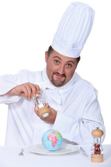 Chef seasoning a globe