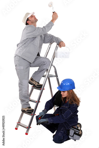 craftsman painter and female electrician working together