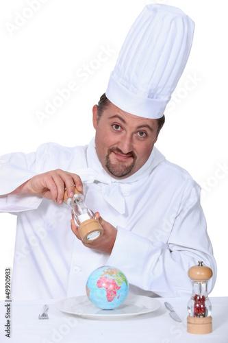 Chef seasoning a globe