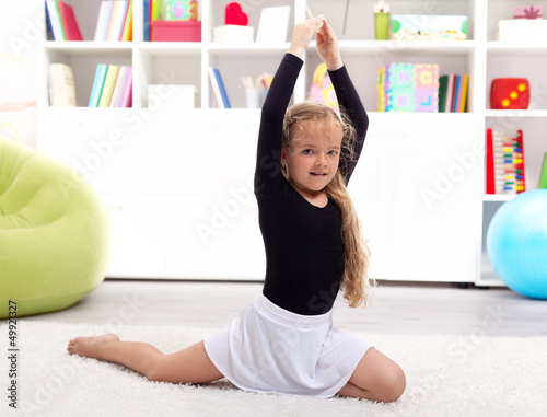Little girl playing ballerina at home