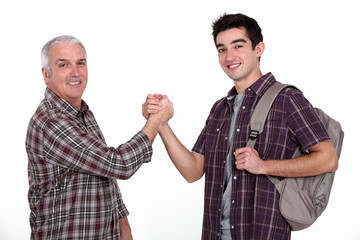 Experienced handyman greeting new starter
