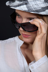 Woman wearing hat and sunglasses