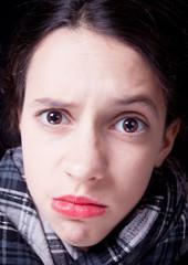 Very skeptic teenage girl