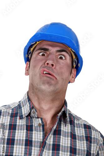 Portrait of grimacing worker
