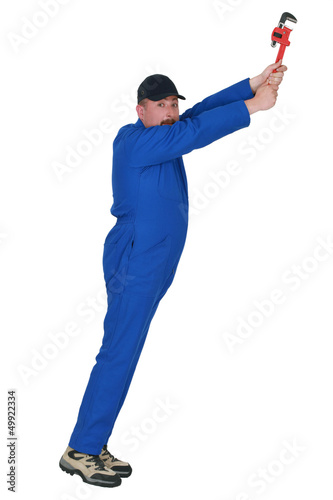 Man with wrench stretching