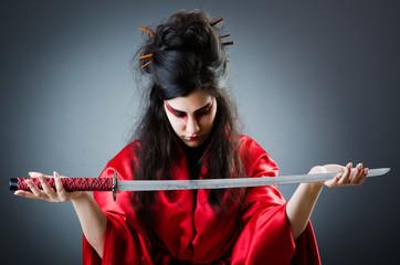 Female sword warriod in dark studio