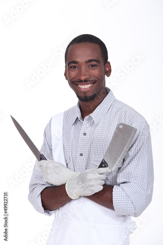 Butcher holding knives