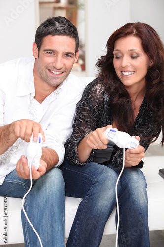 Couple playing a video game together