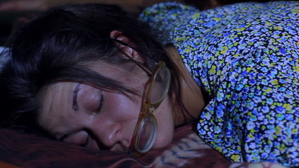 Young untidy woman sleeping.