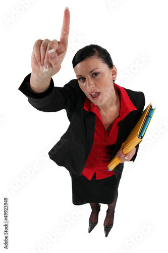 Woman with folders pointing in the air