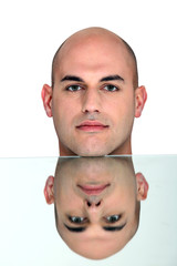 Reflection of bald man