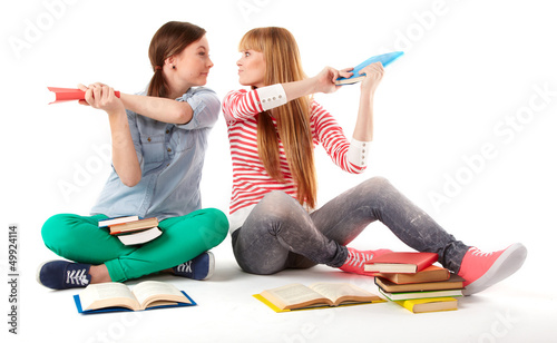 Two Teenage Girls reading The Book.Education