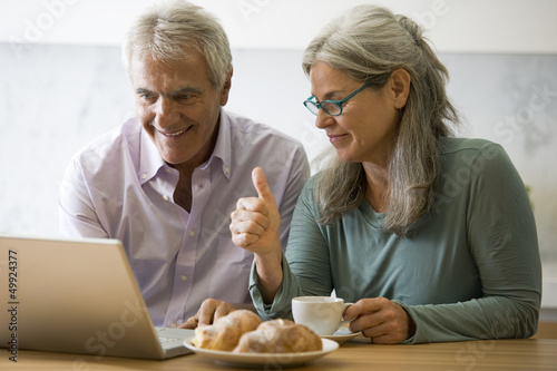 Mature couple at computer