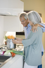 Mature couple cooking spaghetti