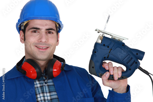 Builder with a jigsaw
