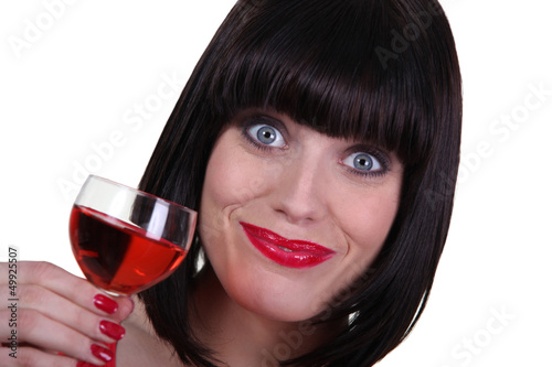 Happy brunette likes wine