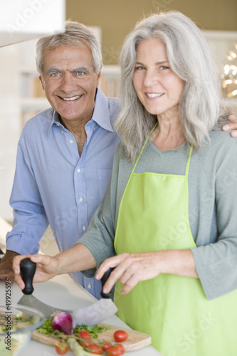 Mature couple preparing food