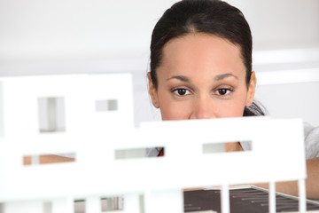 Woman observing architect plan