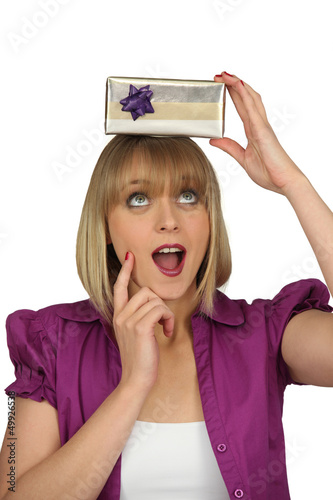 Excited woman holding mystery gift