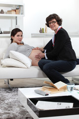 Doctor consulting with pregnant woman