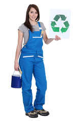 Female painter holding recycle logo
