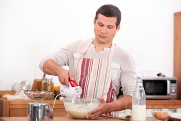 Young man preparing a cake