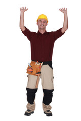 Manual worker with arms raised