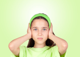 Frightened girl covering her ears