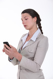 Businesswoman looking at her phone