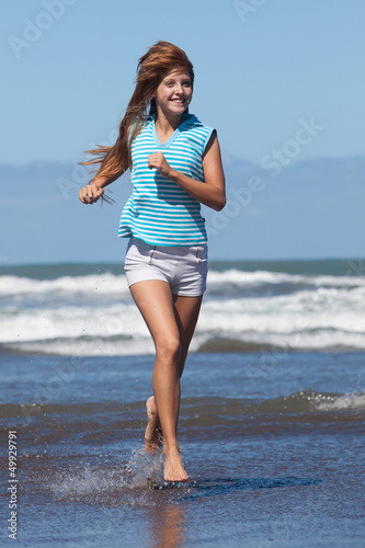 running girl at the beach