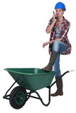 Woman stood with empty wheelbarrow