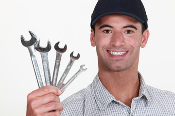 Man holding wrenches