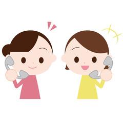 固定電話で話す女性二人