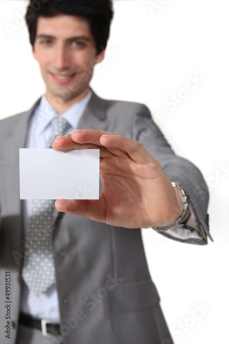 businessman isolated on white background showing business card