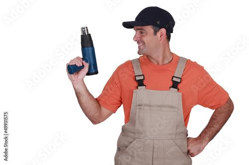 craftsman holding a heat gun