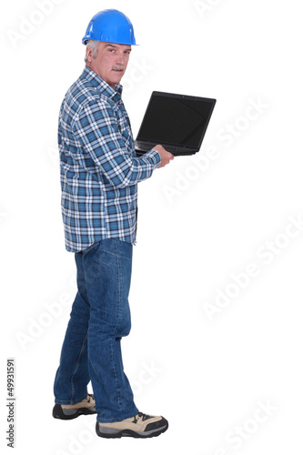 Senior worker holding laptop