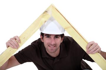 carpenter making a wooden frame