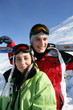 Couple stood on mountain with skis