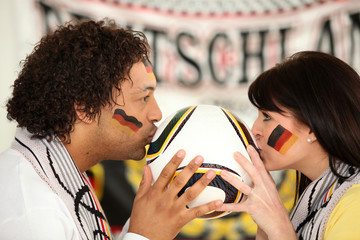 German soccer fans kissing ball