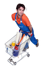 Painter with utensils in shopping cart
